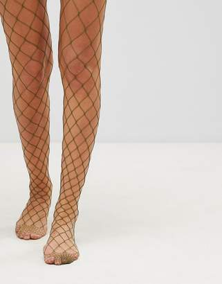 Asos DESIGN Oversized Fishnet Tights in Khaki
