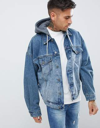 e8973b6d5109 Asos Design DESIGN oversized denim jacket with jersey hood in mid wash