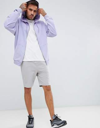 Asos DESIGN oversized zip-up hoodie with acid wash in purple