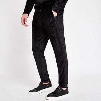 River Island Black velour R96 slim fit piped joggers