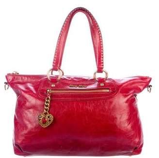 b3a431b3181 Miu Miu Studded Heart Charm Two Way Bag