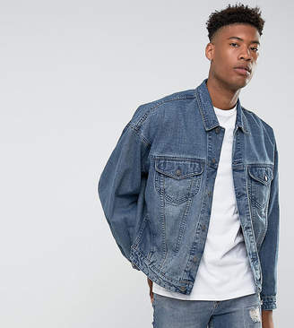 Asos DESIGN tall oversized denim jacket in mid wash