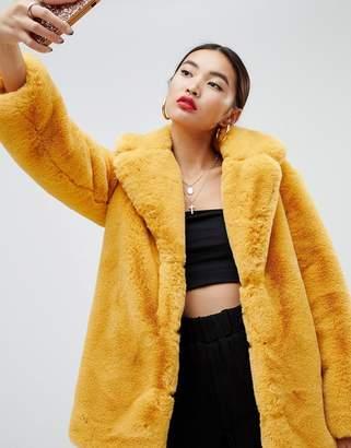 NA-KD oversized faux fur coat in mustard