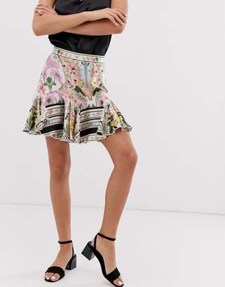 Asos Design DESIGN mini skirt with godet hem in mirrored floral print
