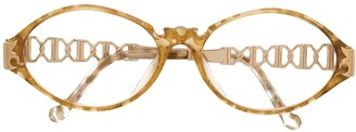 Christian Lacroix Pre-Owned oval frame glasses