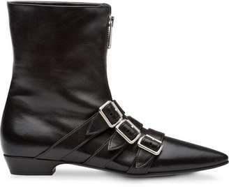 Miu Miu buckled strap boots
