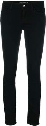 Dolce & Gabbana appliqué heart skinny jeans
