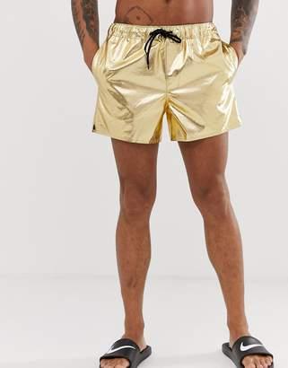 03d27e4cb5 Asos Design DESIGN swim shorts in gold snakeskin in super short length