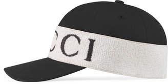 Baseball hat with Gucci headband $440 thestylecure.com