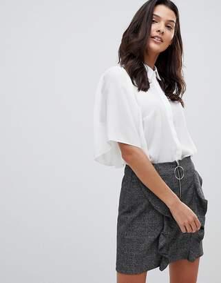 Asos Design DESIGN cropped blouse with flutter sleeve