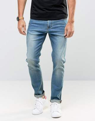 Asos DESIGN Skinny Jeans In Mid Wash
