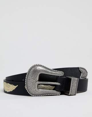 Asos Design DESIGN faux leather slim belt in black with western buckle and feather embroidery