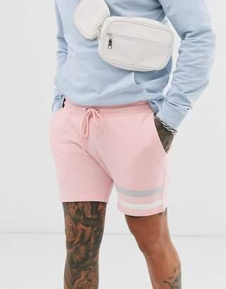 Asos Design DESIGN jersey skinny shorts with ringer details in pink