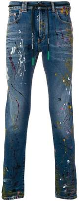 Off-White paint splattered skinny jeans