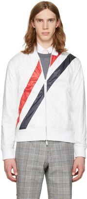 Thom Browne White Three Stripes Bomber Jacket $790 thestylecure.com