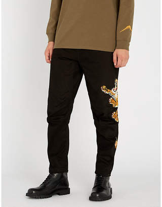MHI Tiger-embroidered relaxed-fit cotton trousers