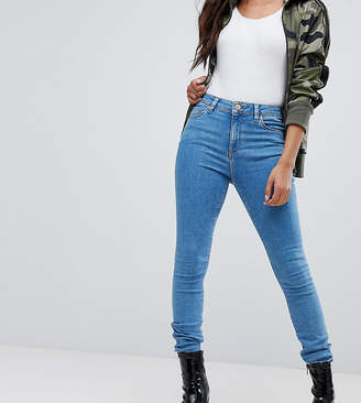 Asos DESIGN Petite Ridley ankle grazer jeans in lily wash