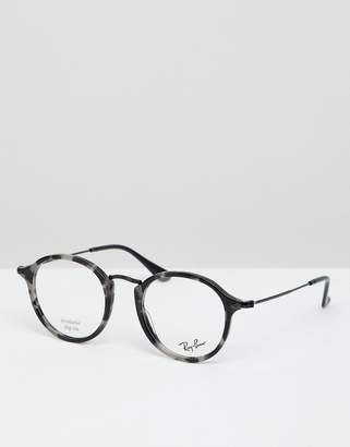 Ray-Ban 0RX2447V round optical frames with demo lenses