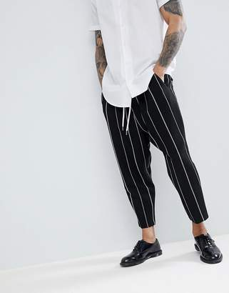 Asos DESIGN drop crotch tapered smart pants in black waffle with white stripes