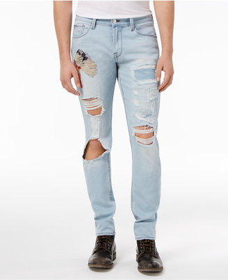 Guess Men's Slim-fit Tapered Deconstructed Jeans $128 thestylecure.com