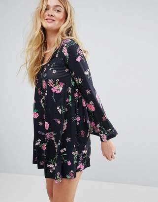 Asos DESIGN Button Through Mini Swing Dress With Trumpet Sleeve In Floral Print