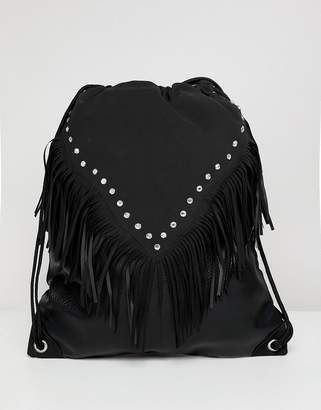 Asos DESIGN festival drawstring backpack in black with geo-tribal and studs