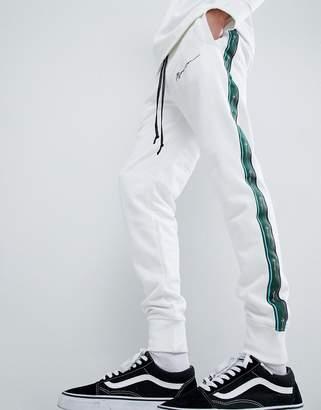 Mennace retro sweatpants in white with logo