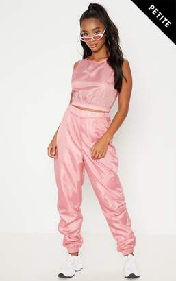 PrettyLittleThing Petite Baby Pink Shell Joggers
