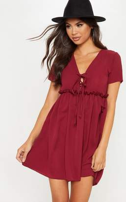 PrettyLittleThing Deep Burgundy Bubble Crepe Lace Up Front Smock Dress