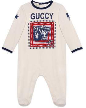 "Gucci Baby sleepsuit with ""Guccy"" print"