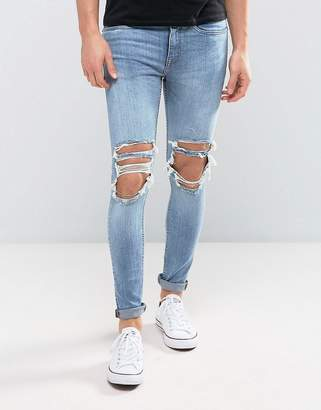 New Look Super Skinny Jeans With Extreme Rips In Mid Wash