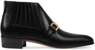 Gucci Men's leather ankle boot with G brogue