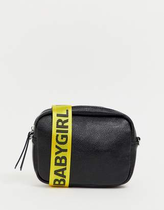 Missguided cross body bag in black with baby girl logo