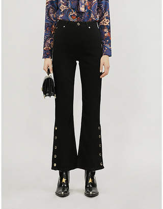 Sandro Buttoned-cuff flared high-rise jeans