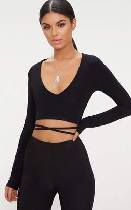 34611729749e00 PrettyLittleThing Black Slinky Long Sleeve Tie Waist Crop Top