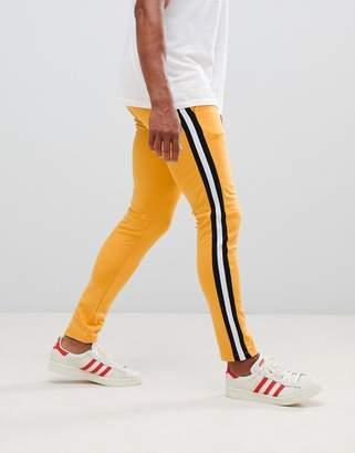 Asos Design DESIGN retro track super skinny joggers with side stripe