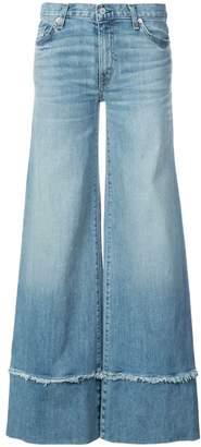 Nili Lotan frayed hem flared jeans
