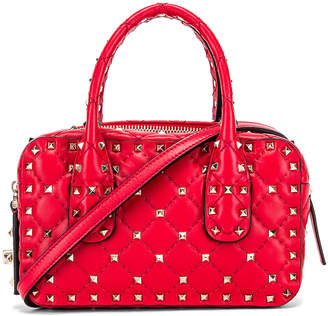 Valentino Rockstud Spike Small Duffle Bag in Rouge | FWRD