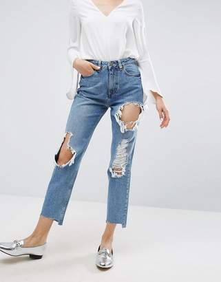 Asos Original Mom Jeans In Phoebe Mid Stonewash With Busts And Stepped Hem