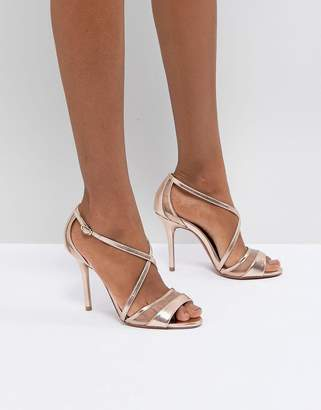 Head Over Heels by Dune Rose Gold Metallic Heeled Sandals
