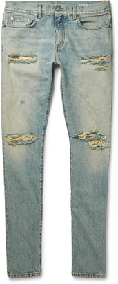 Saint Laurent Skinny-Fit 15cm Hem Distressed Denim Jeans $750 thestylecure.com