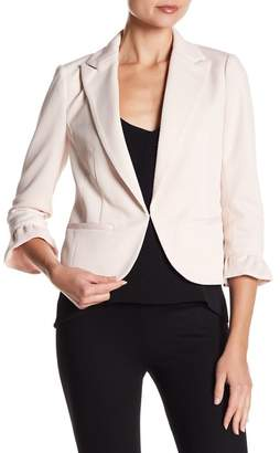 Amanda & Chelsea Ruffle Sleeve Solid Blazer