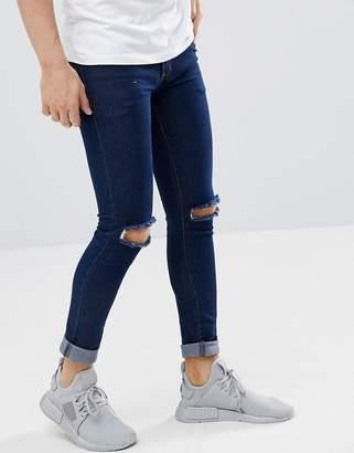 Criminal Damage Super Skinny Jeans in Indigo Ripped