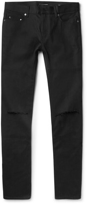 Saint Laurent Skinny-Fit 15cm Hem Distressed Raw Stretch-Denim Jeans $750 thestylecure.com