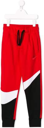 Nike swoosh tracksuit bottoms