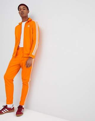 adidas Beckenbauer Joggers In Orange Dh5819