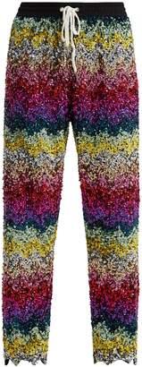 Ashish Striped sequin-embellished cotton track pants