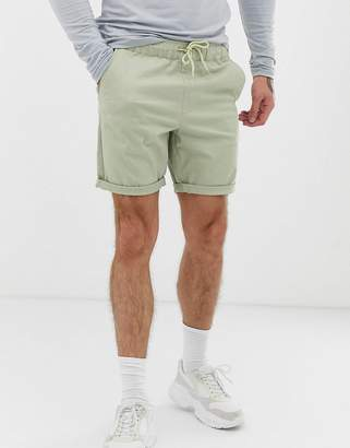 Asos Design DESIGN slim chino shorts with elastic waist in light green
