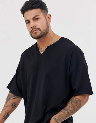 Asos Design DESIGN oversized t-shirt with raw notch neck in black
