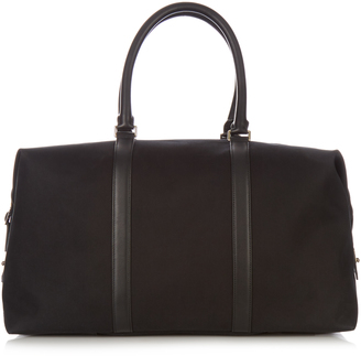 PAUL SMITH SHOES & ACCESSORIES Leather-trimmed canvas weekend bag $593 thestylecure.com